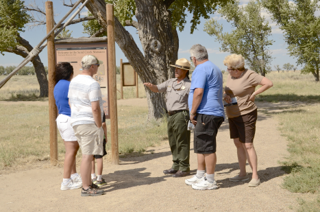 PICT - Visitors at Sand Creek National Historic Site with Guide Mario Medina - NPS Photo