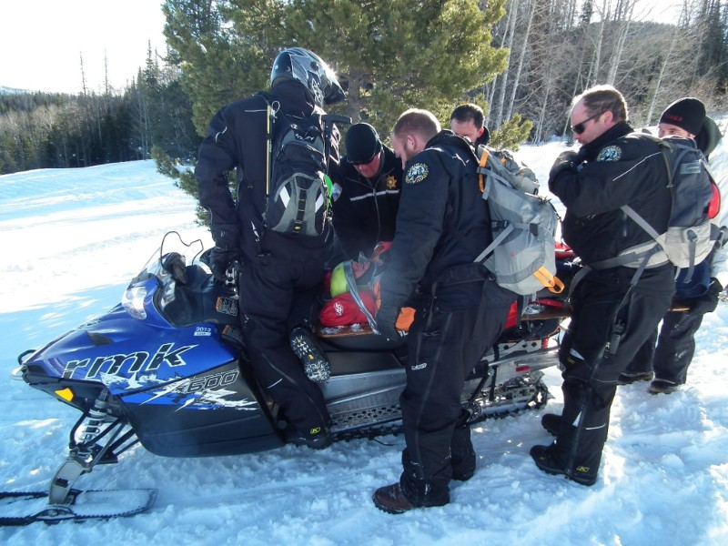 PICT Loading Injured Snow Machine Rider - CPW