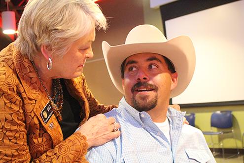 PICT Judy Reyher congratulate outgoing pres Nolan Davis
