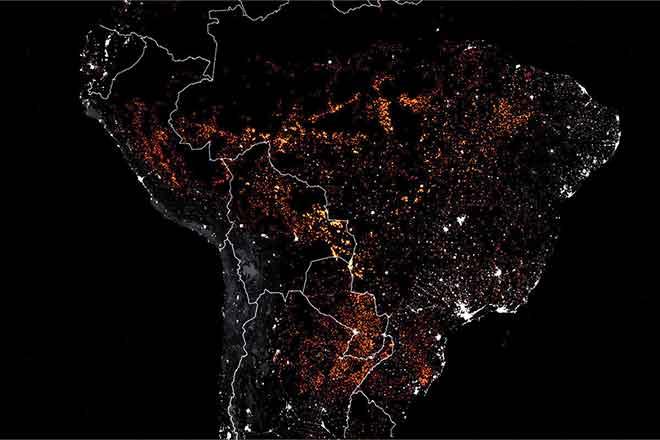 PICT Satellite image of Amazon rainforest fires - EarthTalk - Joshua Stevens, NASA Earth Observatory