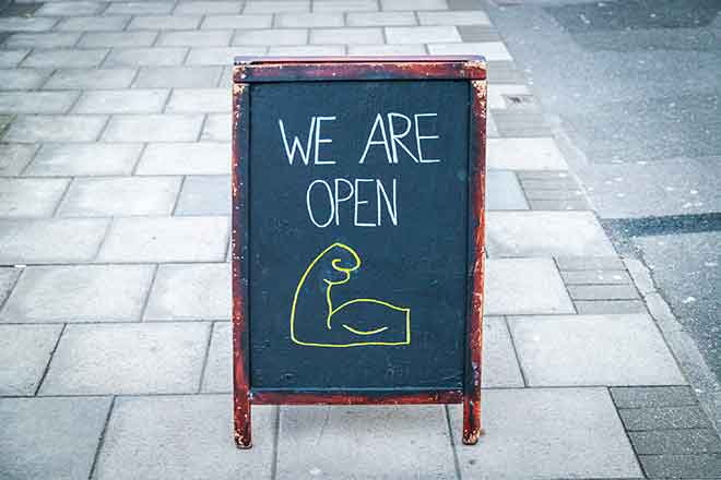 PROMO 64J1 Business - Sign Open Chalk Board Arm - iStock - mikeinlondon