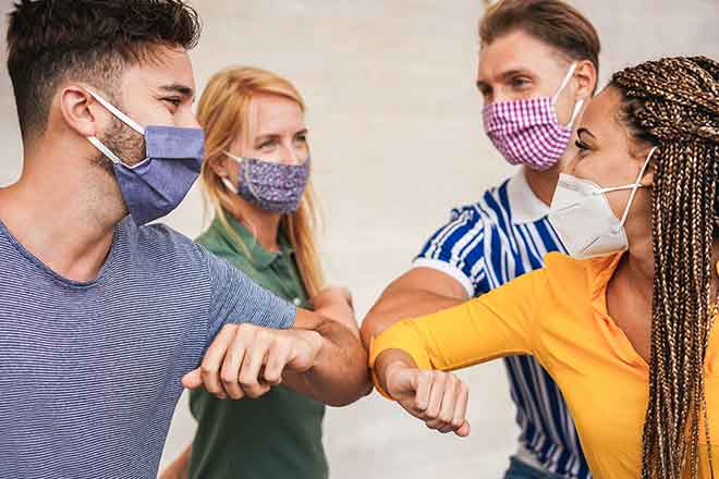 PROMO 64J1 Health - Mask People Elbow Bump - iStock - DisobeyArt