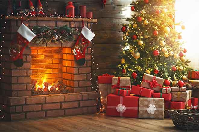 PROMO 64J1 Holiday - Fireplace Stockings Tree Gifts Presents - iStock - evgenyatamanenko