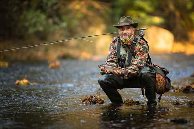 PROMO Outdoors - Fishing Man Stream - iStock - ViktorCap