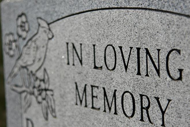 PROMO 660 x 440 Obituary - Grave Marker In Loving Memory - iStock