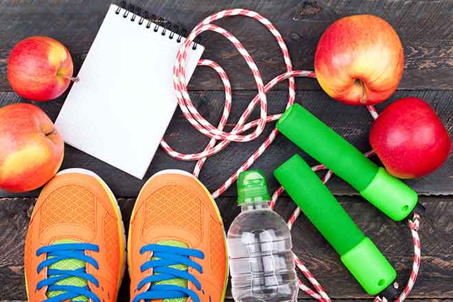 Health - Fitness Shoes Water Bottle Apple Jump Rope Note Pad - iStock - LanaSweet