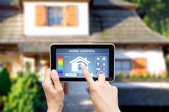PROMO 660 x 440 Miscellaneous - Home Control Automation Tablet Hand House - iStock - scyther5