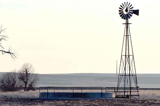 PROMO 660 x 440 Agriculture - Windmill Stock Tank Prairie Sillhouette - Chris Sorensen