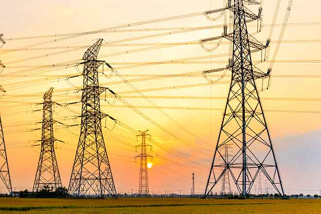 PROMO 64J1 Energy - Power Lines Sky Sunset Clouds High Voltages - iStock - zhaojiankang