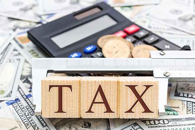 PROMO Government - Taxes Money Calculator Word Blocks - iStock - LIgorko