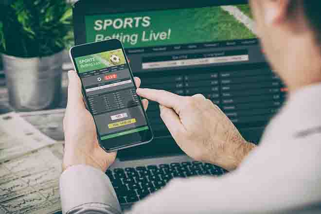 PROMO 64J1 Miscellaneous - Gambling Betting Sports Phone Computer - iStock - scyther5