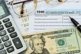 PROMO 660 x 440  Money - Tax Form Calculator Money Glasses - iStock