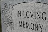 Obituary - Grave Marker In Loving Memory - iStock - melissarobison