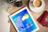 PROMO Weather - Forecast Tablet Coffee Camera Passport Travel - iStock - LuckyBusiness