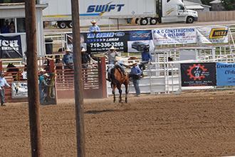 Ranch bronc riding at the Kiowa County fairgrounds Saturday night!
