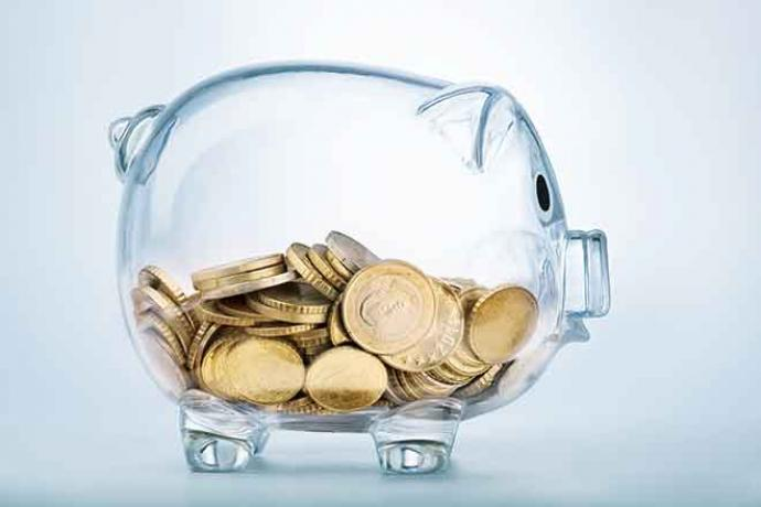 PROMO Finance - Money Glass Piggy Bank with Coins - iStock - Pogonici