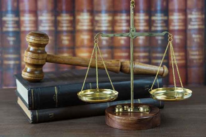 Government - Legal Justice Scales Gavel Law Books Crime - iStock - Epitavi