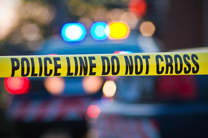 PROMO 660 x 440 Crime - Police Line Cross Light Law Enforcement Investigation - iStock