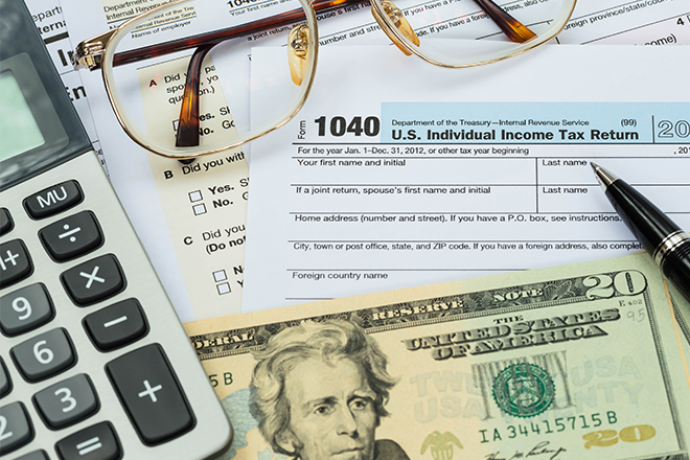 PROMO 660 x 440  Money - Tax Form Calculator Money Glasses - iStock