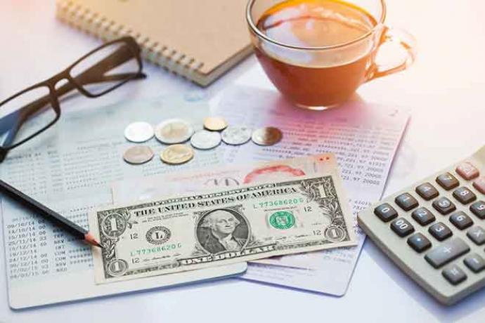 PROMO Finance - Money Dollar Calculator Glasses Statement Bank - iStock - Mamphotography