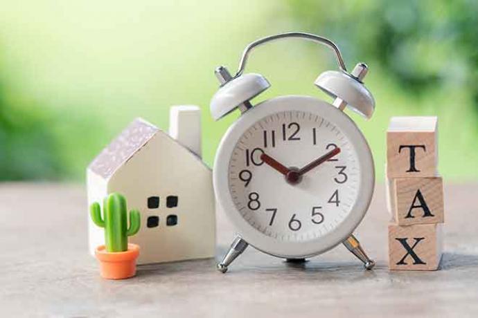 PROMO Government - Tax Home House Clock Time - iStock - supawat bursuck