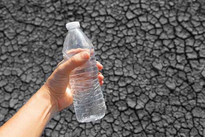 PROMO 660 x 440 Miscellaneous - Drought Water Bottle Cracked Mud - iStock