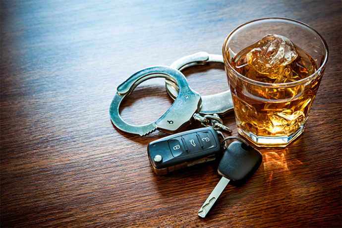 PROMO 660 x 400 Crime - Drink Drive Whiskey Alcohol Key Fob Handcuff Table Glass - iStock - AlexRaths