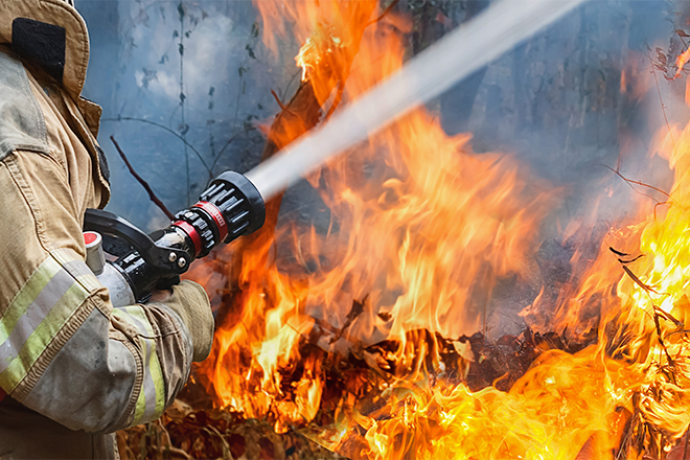 PROMO 660 x 440 Fire - Firefighter Hose Water Flame - iStock