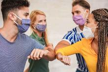 PROMO 64J1 Health - Mask People Elbow Bump - iStock - DisobeyArt