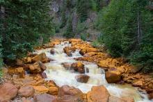 PROMO Outdoors - Red Mountain Creek Colorado Water Stream River - iStock - Aaron Hawkins