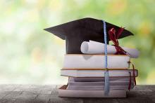 PROMO Education - Graduation Cap Diploma Books - iStock - leolintang