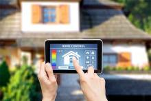 PROMO 64J1 Miscellaneous - Home Control Automation Tablet Hand House - iStock - scyther5