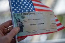 PROMO Money - Relieve Program Check United States Flag Stimulus - iStock - Evgenia Parajanian