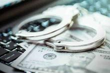 PROMO 64J1 Technology - Cyber Crime Handcuffs Money Computer Keyboard - iStock - turk_stock_photographer
