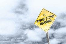 PROMO Weather - Sign Winter Storm Warning Snow Ice - iStock - ronniechua