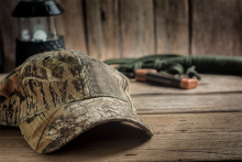 PROMO 660 x 440 Outdoors - Hunting Hat Camo Lantern Table Gear - iStock - Golfcuk